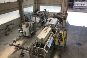 A complete line of carbonation machines working